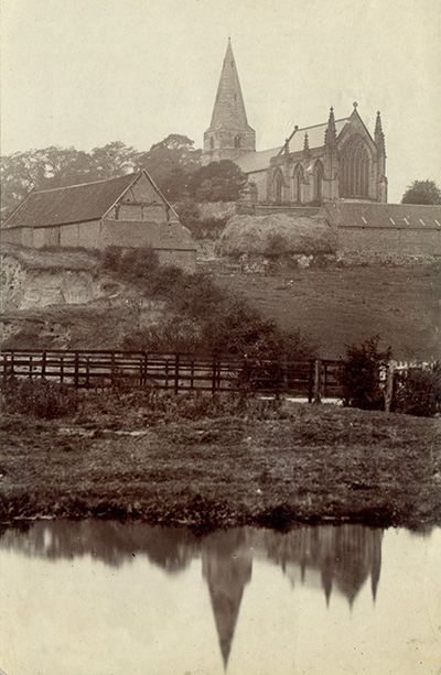An old photograph of Cloudside Farm and St. Giles' Church