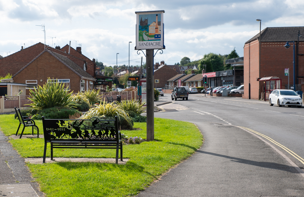 View of the Village Sign and WW1 and WW2 Memorial Benches in Sandiacre
